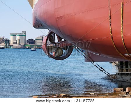 new ship launching in shipyard, side view