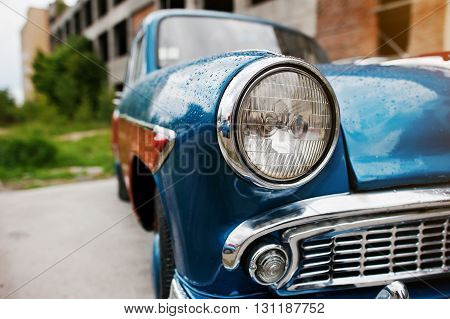 Old vintage car headlight close up. Classic cars
