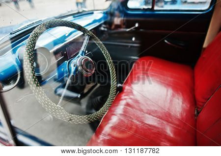 Interior And Steering Wheel With Red Leather Seats On Old Vintage Retro Car