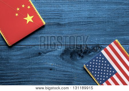 American and Chinese flag on wooden background