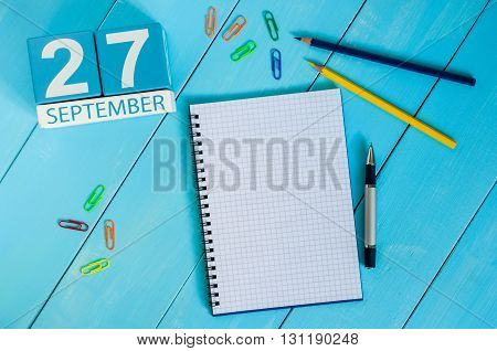 September 27th. Image of september 27 wooden color calendar on white background. Autumn day. Empty space for text.