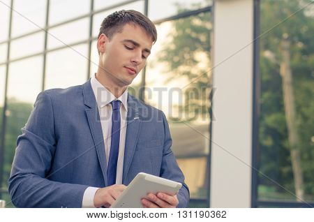 businessman working with his laptop. Handsome young man