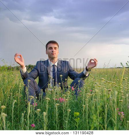 happy businessman outdoor do yoga exercise lotus