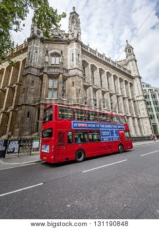 LONDON, UK - AUG 24, 2014: Famous London red bus picking up commuters in the streets of London during the daytime.
