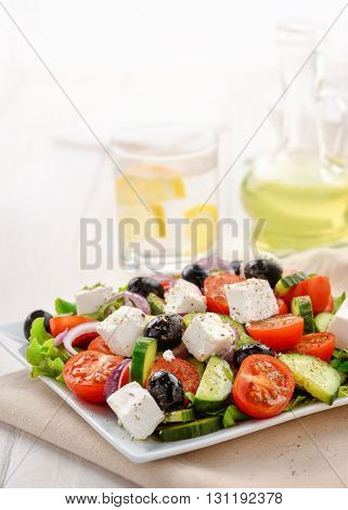 Fresh vegetable greek salad isolated on white