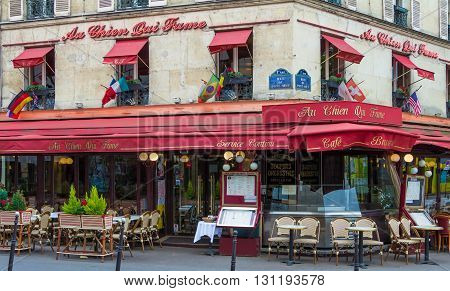 Paris France-May 15 2016 : The famous parisian cafe Au chien qui fume has 275 years of existence it located in Les Halles district of Paris.There are authetic flavors of Parisian culinary tradition and old recipes.
