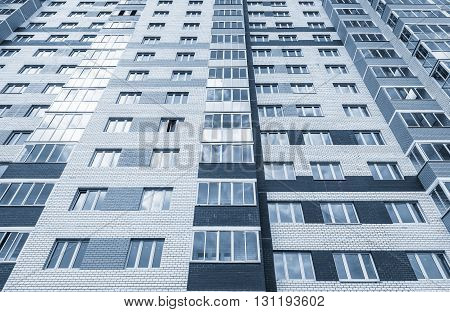 Exterior of the apartment building on sunny day.