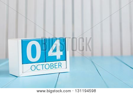 October 4th. Image of October 4 wooden color calendar on white background. Autumn day. Empty space for text.