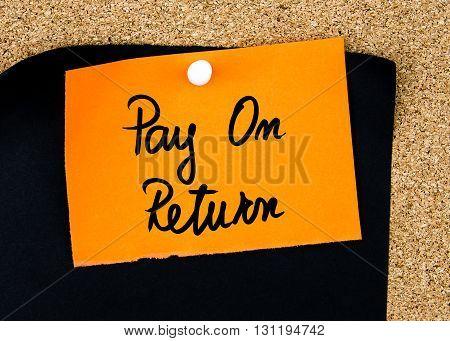 Pay On Return Written On Orange Paper Note