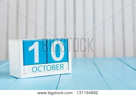 October 10th. Image of October 10 wooden color calendar on white background. Autumn day. Empty space for text.