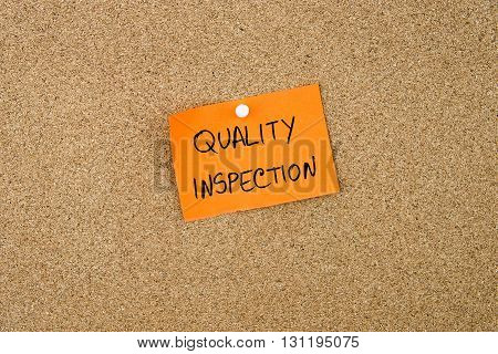 Quality Inspection Written On Orange Paper Note