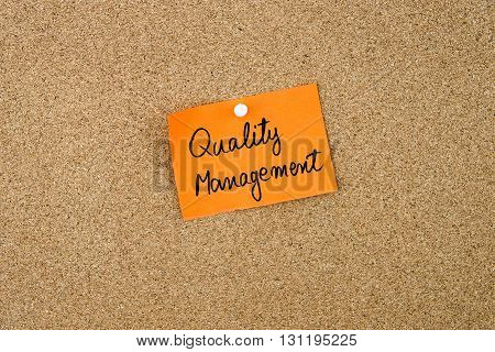 Quality Management Written On Orange Paper Note