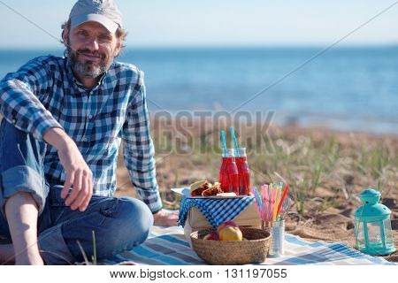Mature man during sea picnic