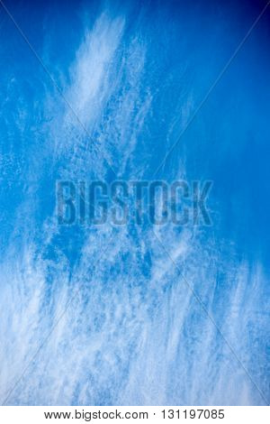 Beautiful blue sky with scattered clouds on a summer day
