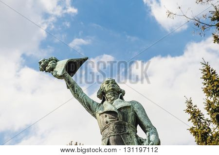 STRASBOURG FRANCE - APR 19 2016: Man holding hat saluting victory statue representing Kellermann French Marechal Duc de Valmy