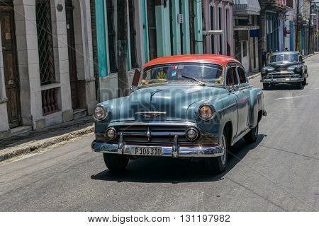 Havana, Cuba - June 23, 2015: A couple of old american cars on the streets of Centro Havana district