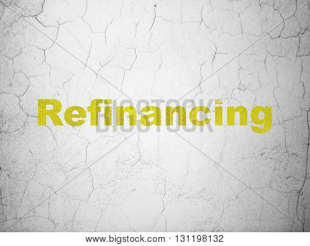 Business concept: Yellow Refinancing on textured concrete wall background