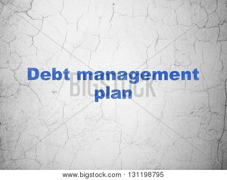 Finance concept: Blue Debt Management Plan on textured concrete wall background