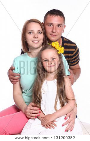 cute young family on white