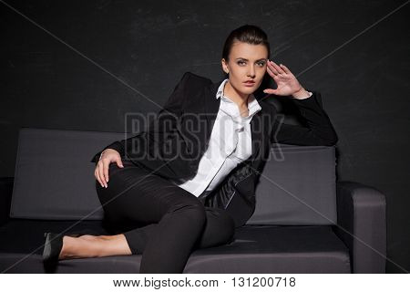 girl model posing on the couch in the Studio