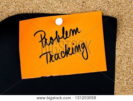 Problem Tracking Written On Orange Paper Note