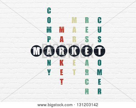 Marketing concept: Painted black word Market in solving Crossword Puzzle