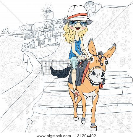 Beautiful girl tourist in sunglasses and hat riding on a donkey in the village of Oia, Santorini, Greece