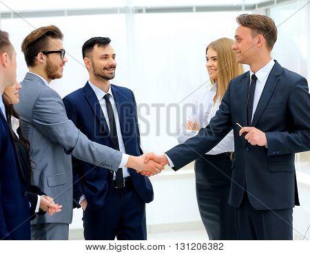 businessmen handshaking after presentation