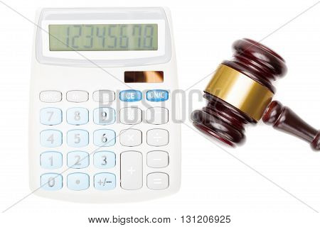 Wooden Judge's Gavel Near Calculator - Close Up Studio Shot