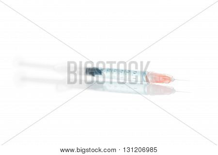 Syringe With Blue Solution Inside - Close Up Studio Shot