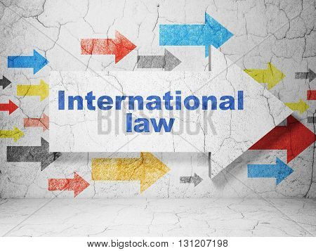 Political concept:  arrow with International Law on grunge textured concrete wall background, 3D rendering