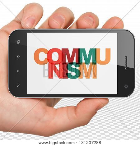 Political concept: Hand Holding Smartphone with Painted multicolor text Communism on display, 3D rendering