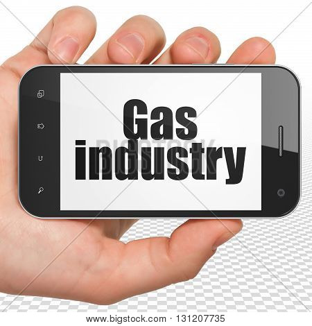 Manufacuring concept: Hand Holding Smartphone with black text Gas Industry on display, 3D rendering