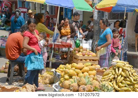 QUETZALTENANGO GUATEMALA APRIL 28 2016 : People sell fruits in Quetzaltenango maket. This native market is the most colorful in Central America