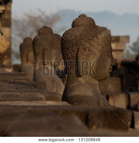 Buddha statues at Borobudur temple near Yogyakarta, Java, Indonesia.