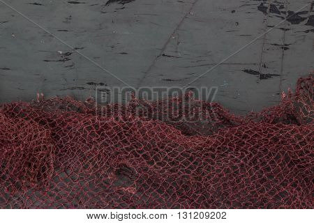 Hanging Fishnet On Gray Wood Wall