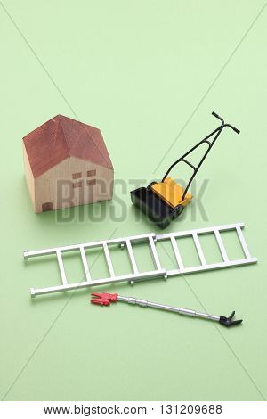 House, ladder, high branch pruning shears, and lawn mower.