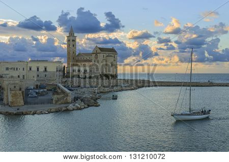 Harbor at sunset:Trani cathedral(Apulia) -ITALY-It is a great example of Apulian Romanesque architecture.It was built using a calcareous tuff, characterised by its colour, an extremely light pink.