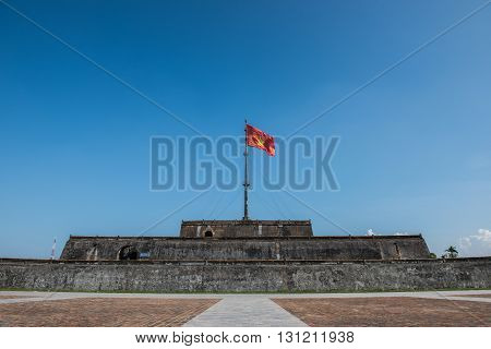 Flag tower with the Vietnamese National flag in the Imperial Citadel of Hue. It belonged to the Nguyen dynasty until Vietnam's independence in 1945.