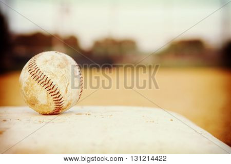 Baseball sitting on a base