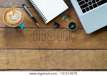 Office desk with labtop blank screen leather notebook pen and coffee cup .Top view with copy space