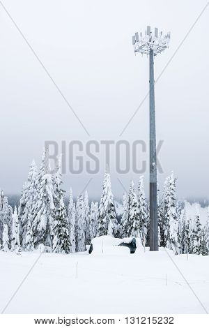Snow covered telecommunication tower in the winter