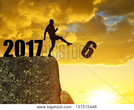 Silhouette of man kicked to six. Concept New Year 2017