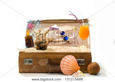Full open suitcase travel concept  isolated on white selective focus