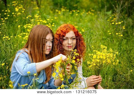 Best friends forever. Girlfriends collect bouquets of wildflowers. BFF.