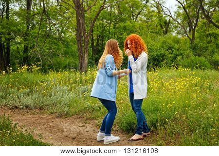 Best friends forever. Girlfriends spend time together in the park. BFF. Close friends. Gentle friendship. Girls laugh