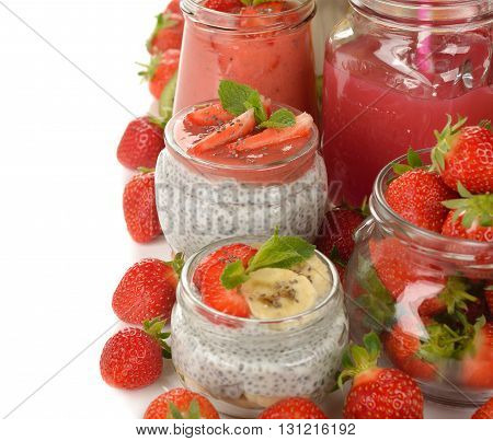 Diet desserts and drinks with chia seeds and strawberries on white background