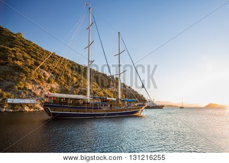 Calm bay with anchored sail boats. Turkey