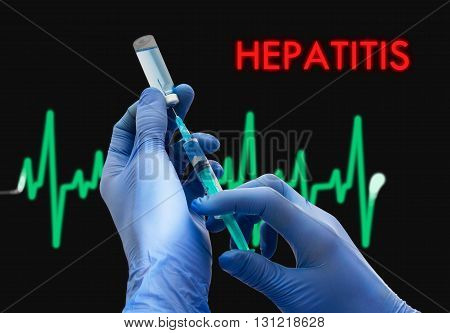 Treatment of Hepatitis. Syringe is filled with injection. Syringe and vaccine. Medical concept.