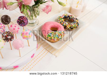 Donuts and cakepops on buffet at the party